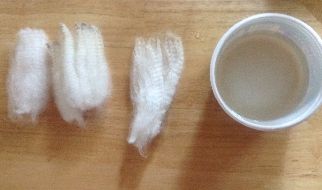 Pictured from left to right, clean white control lock (what I'm aiming for, dirty lock pre hydrogen peroxide, and post HP soak