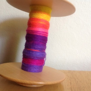 First bobbin of rolags, spun thin. 3 rolags