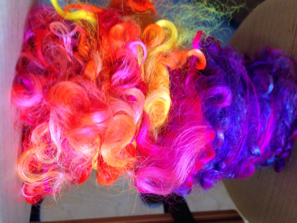 Rolags with teeswater locks spun in I love the silky locks
