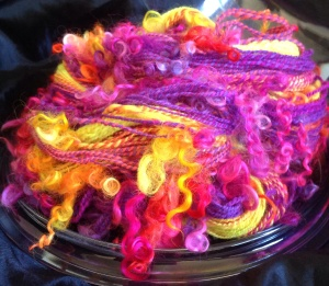 Neon sunset polworth silk with teeswater curl add ins 214 yards of happy